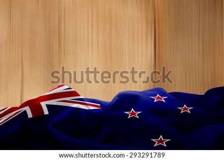 New Zealand flag and wood background - stock photo