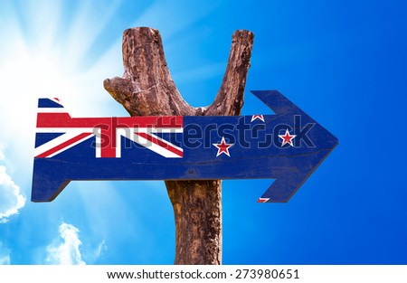 New Zealand Flag wooden sign with sky background - stock photo