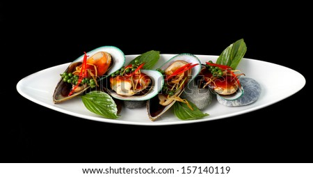 New Zealand green mussels on white background - stock photo