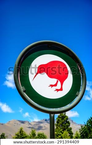 New Zealand. Kiwi sign on blue sky. - stock photo
