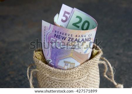 New Zealand money in a hessian bag - stock photo
