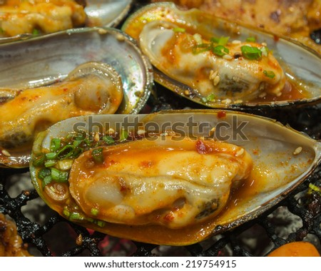 New Zealand mussels BBQ on the grill - stock photo