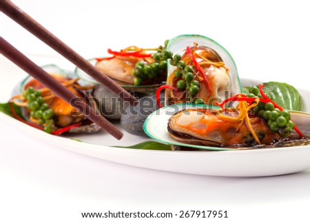 New Zealand mussels in the palette, served with pepper. - stock photo