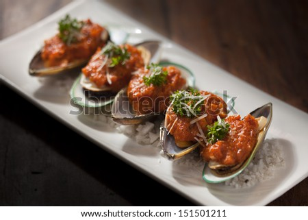 new zealand mussels with tomato sauce - stock photo