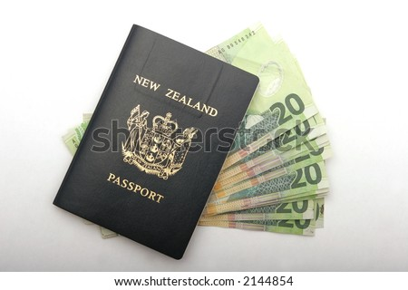 New Zealand passport with twenty dollar bills in it, to bribe customs maybe? - stock photo
