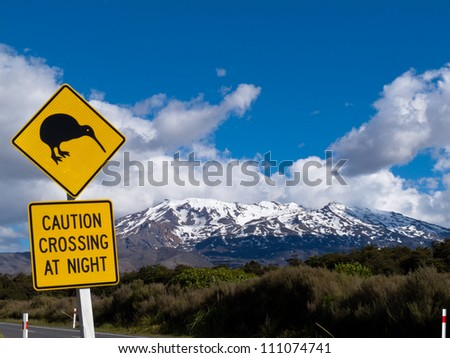 New Zealand Road Sign Attention Kiwi Crossing at road near active volcano of Mount Ruapehu in Tongariro National Park - stock photo