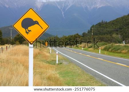 New Zealand symbol - kiwi sign. Tasman region road. Focus on the roadsign. - stock photo