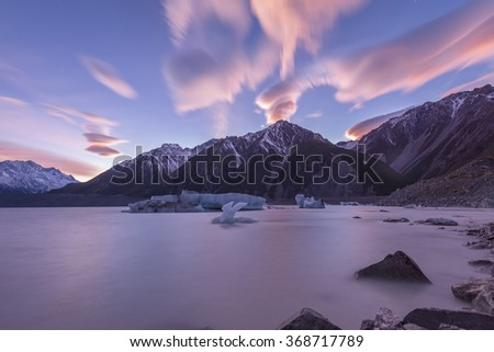 NEW ZEALAND 18TH APRIL 2014 ; Lenticular Cloud Over Mount Cook during a Sunrise  - stock photo