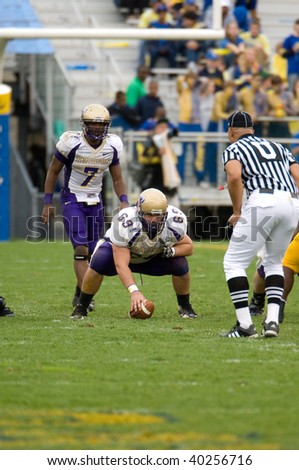 NEWARK, DE - OCTOBER 31: James Madison University football center Donny Smith (#69) prepares to snap the ball in the October 31, 2009 game in Newark, DE.