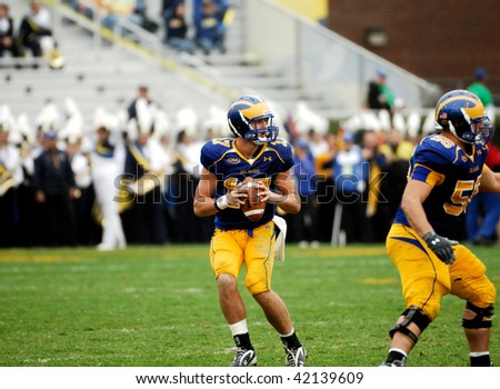 NEWARK, DE - OCTOBER 31: University of Delaware quarterback Pat Devlin (with ball) takes a snap during the October 31, 2009 loss to JMU in Newark, DE. - stock photo