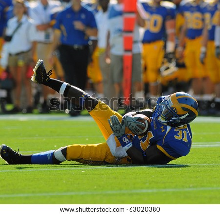 NEWARK, DE - OCTOBER 9: University of Delaware wide receiver Phillip Thaxton cradles the ball following a catch in a game against Maine October 9, 2010 in Newark, DE. - stock photo
