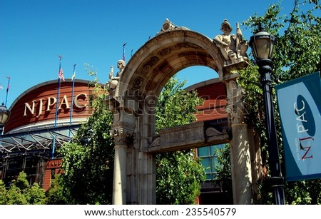 Newark, New Jersey - July 18, 2012:  Neo-romanesque archway entrance and Prudential Hall at the New Jersey Performing Arts Center - stock photo