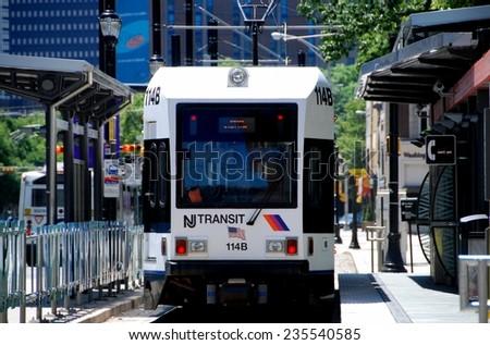 Newark, New Jersey - July 18, 2012: NJ Transit light rail trolley stopped at the Washington Park station - stock photo