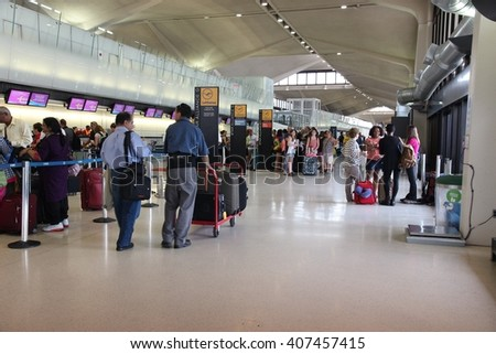 NEWARK, USA - JULY 7, 2013: People wait at Newark Liberty Airport in Newark. With 33.7 millions of total passenger traffic it is the 14th busiest airport in the US (2011). - stock photo