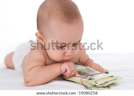 newborn and money on a white background - stock photo