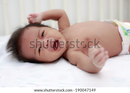 Newborn Asian baby crying, 27 days after birth - stock photo