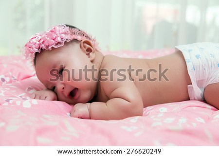 Newborn Asian baby . 55 days after birth, process color
