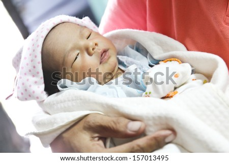 Newborn Asian baby girl sleeping - stock photo