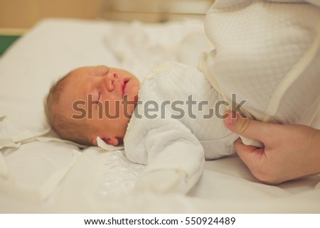 newborn baby and mother in the delivery room, the hospital
