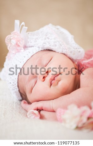 newborn baby (at the age of 14 days) sleeps in a knitted  hat