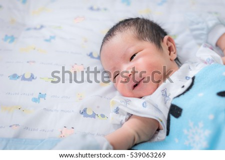 newborn baby boy asian