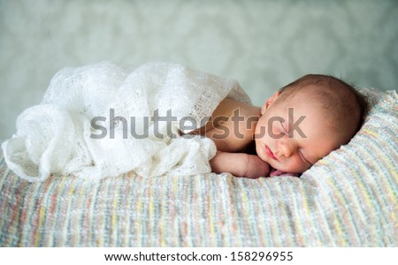 Newborn baby boy asleep - stock photo