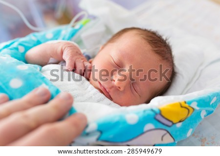 Newborn baby boy in the hospital after c-section - stock photo