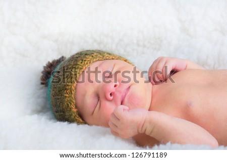 Newborn baby boy peacefully sleeping - stock photo
