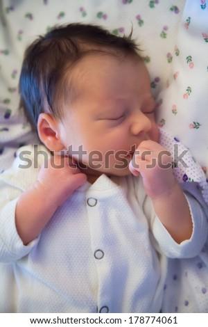 Newborn baby boy portrait while still in hospital