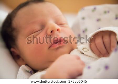 Newborn baby boy portrait while still in hospital. - stock photo