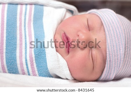 Newborn baby boy resting in hospital - stock photo