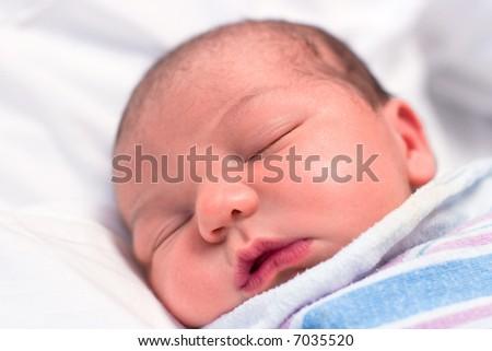 Newborn baby boy sleeping in hospital - stock photo