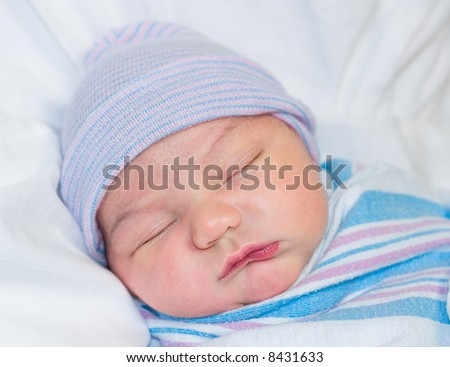 Newborn baby boy sleeping in hospital