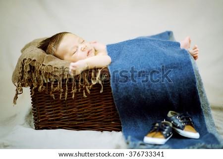 Newborn Baby Boy Sleeping in the Basket - stock photo