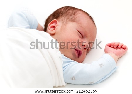Newborn baby boy sleeping. Newborn Sleep. Two weeks old - stock photo