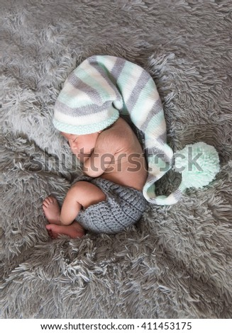 Newborn baby boy sleeps in cute hat. NJ, USA. Febr, 2016  - stock photo