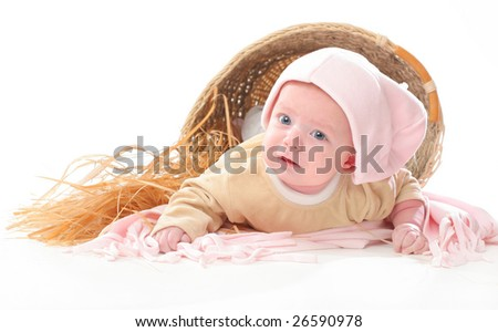 newborn baby crawling out of the basket