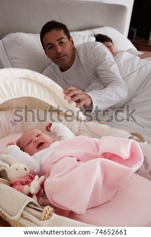 Newborn Baby Crying In Cot In Parents Bedroom - stock photo