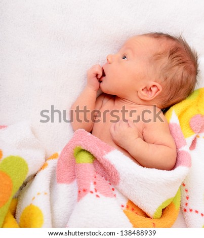 newborn baby, cute infant in bed - stock photo
