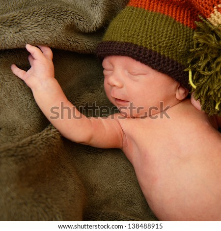 newborn baby, cute sleeping infant in green soft plaid - stock photo