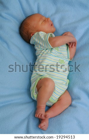 Newborn baby - 5 days old baby sleeping - stock photo