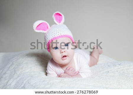 newborn baby dressed in bunny - stock photo
