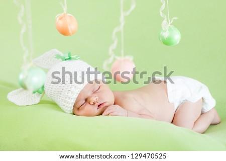 newborn baby dressed in Easter bunny cap - stock photo