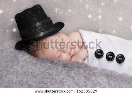 Newborn baby  dressed up as Frosty the snowman