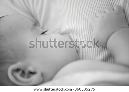 Newborn baby feeding milk