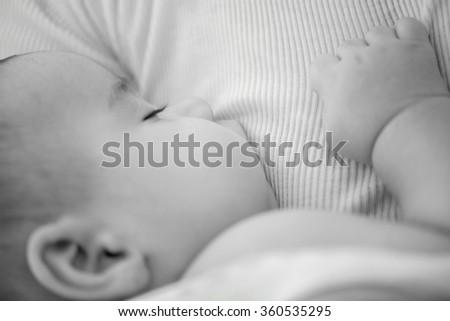 Newborn baby feeding milk - stock photo