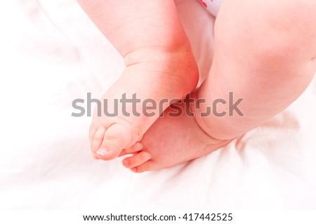 Newborn baby feet.  - stock photo