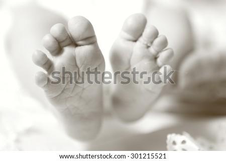 Newborn baby feet, Close up, Sepia - stock photo