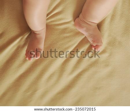 newborn baby feet , closeup - stock photo