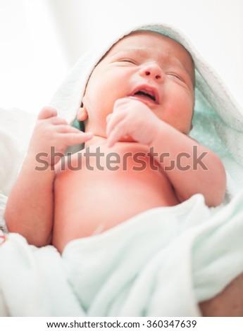 Newborn baby first bath - stock photo